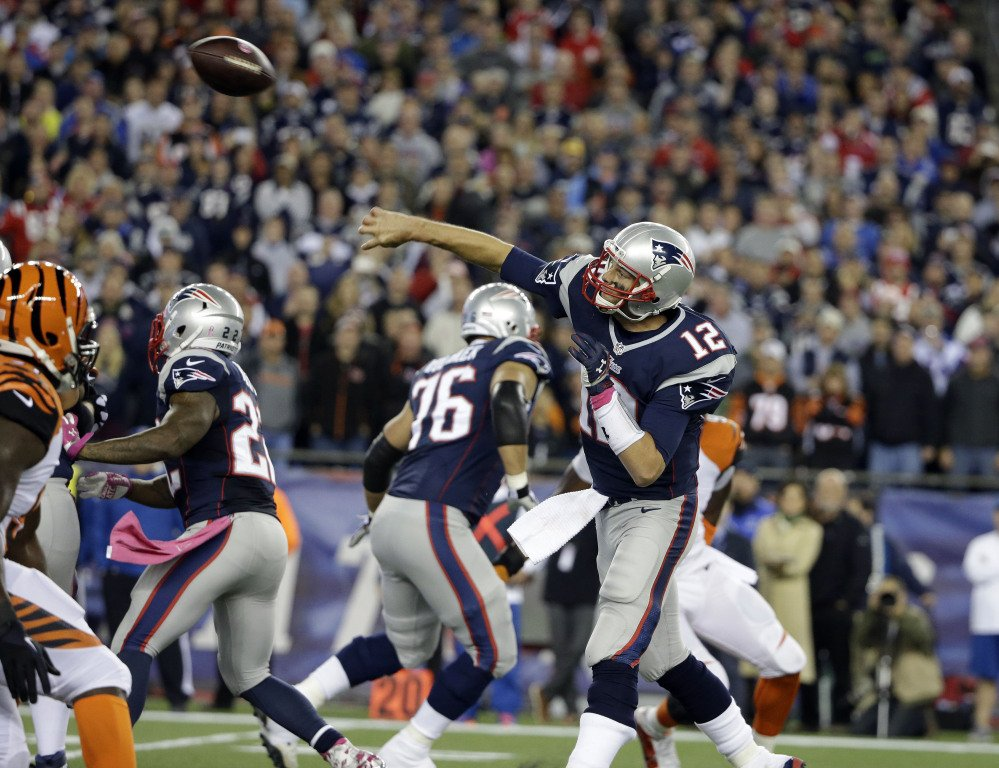 New England Patriots quarterback Tom Brady (12) throws a touchdown pass to  tight end Timothy Wright in the first half of an NFL football game against the Cincinnati Bengals Sunday.