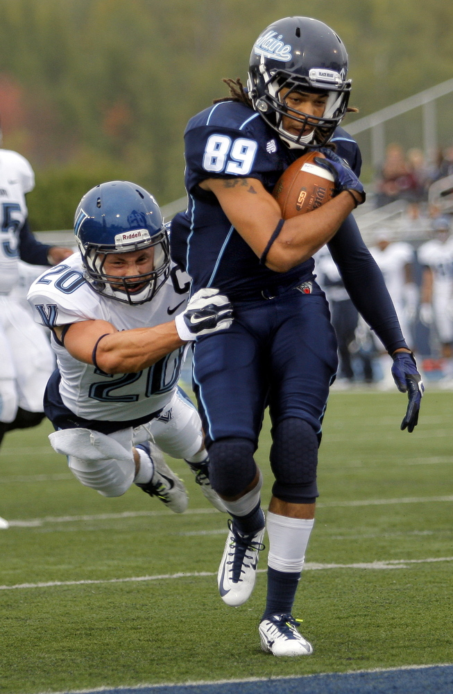Maine's Arthur Williams drags Villanova's Joe Sarnese into the end zone with him after catching a 25-yard touchdown pass from quarterback Dan Collins  Saturday.
