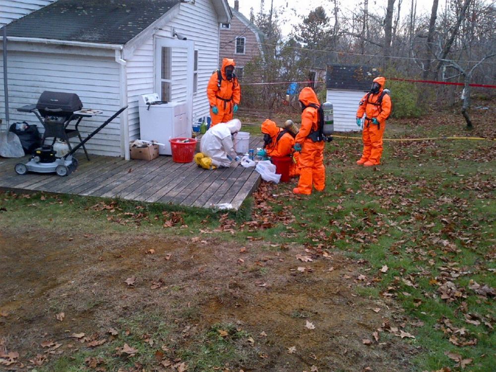 Members of the state's Clandestine Drug Laboratory Enforcement Team dismantle and seize evidence at an Owls Head home in November 2013.