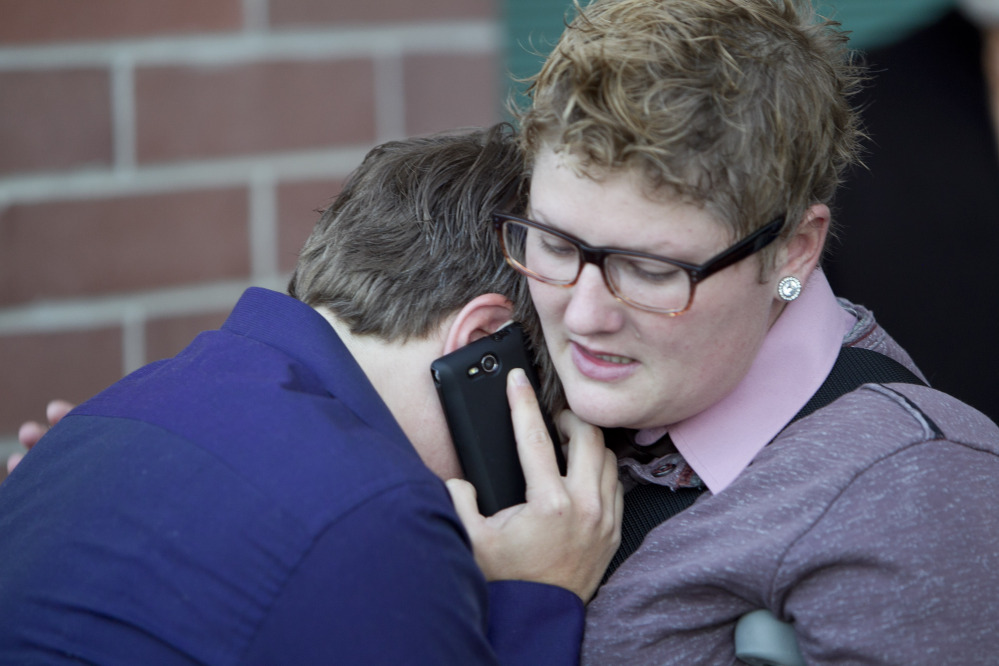 Rachael Beierle, right, consoles partner Amber Beierle after they were denied the opportunity for a marriage license inside the Ada County Courthouse on Wednesday in Boise, Idaho.