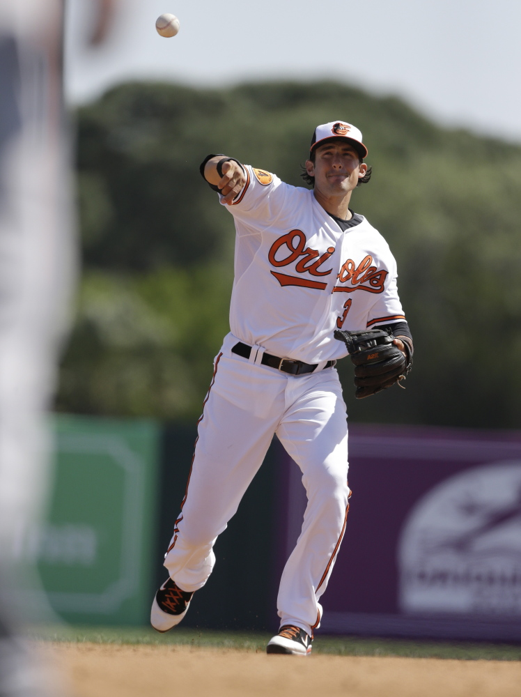 The Orioles' Ryan Flaherty excelled in baseball as a youngster with an assist from his father, Ed, the longtime baseball coach at the University of Southern Maine. Ryan Flaherty was the 11-year-old batboy when the Huskies won the NCAA Division III championship in 1977.