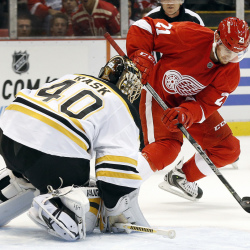 Boston Bruins goalie Tuukka Rask stops a shot by Detroit Red Wings left wing Tomas Tatar in the second period Thursday night in Detroit. The Red Wings scored twice in the period and beat the Bruins, 2-1.