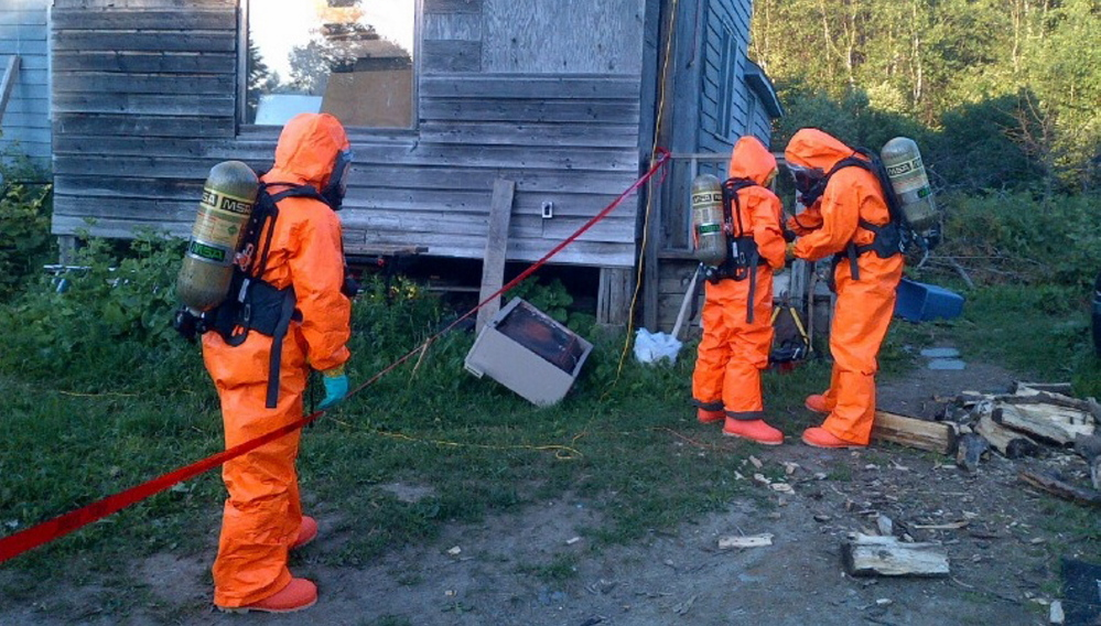Members of the state's Clandestine Drug Laboratory Enforcement Team seize evidence in Owls Head in 2013. Maine has already responded to as many methamphetamine operations this year – 20 – as it did in all of 2013.