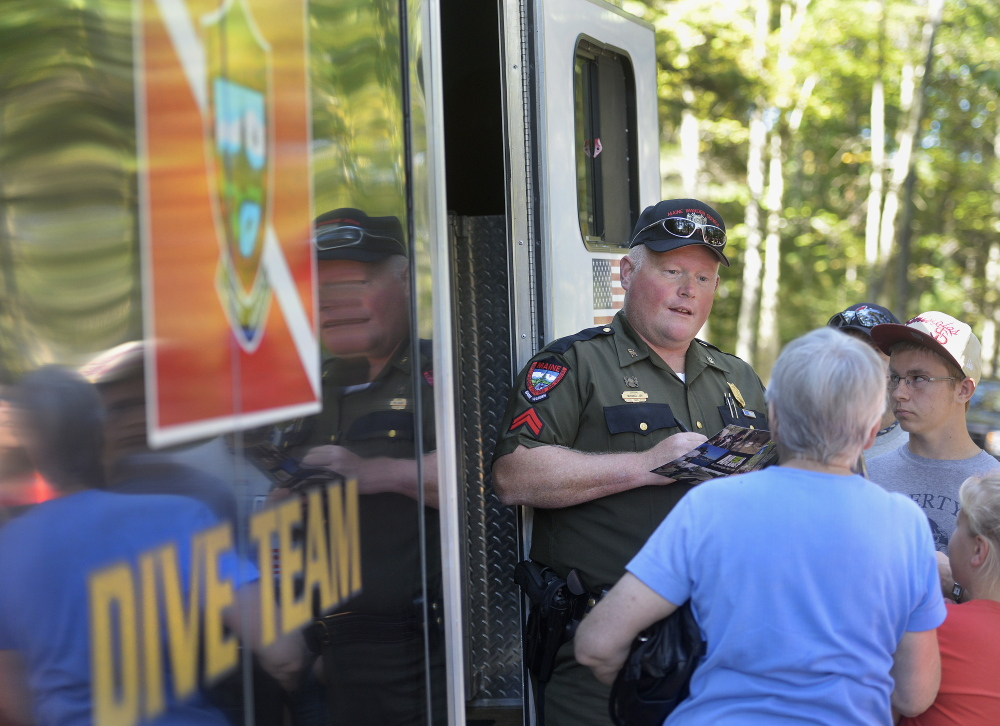 """Warden Michael Joy, a member of the dive team, is at ease putting himself at risk in Maine's waterways – and meeting fans of """"North Woods Law"""" during a meet-and-greet last month in Gray."""