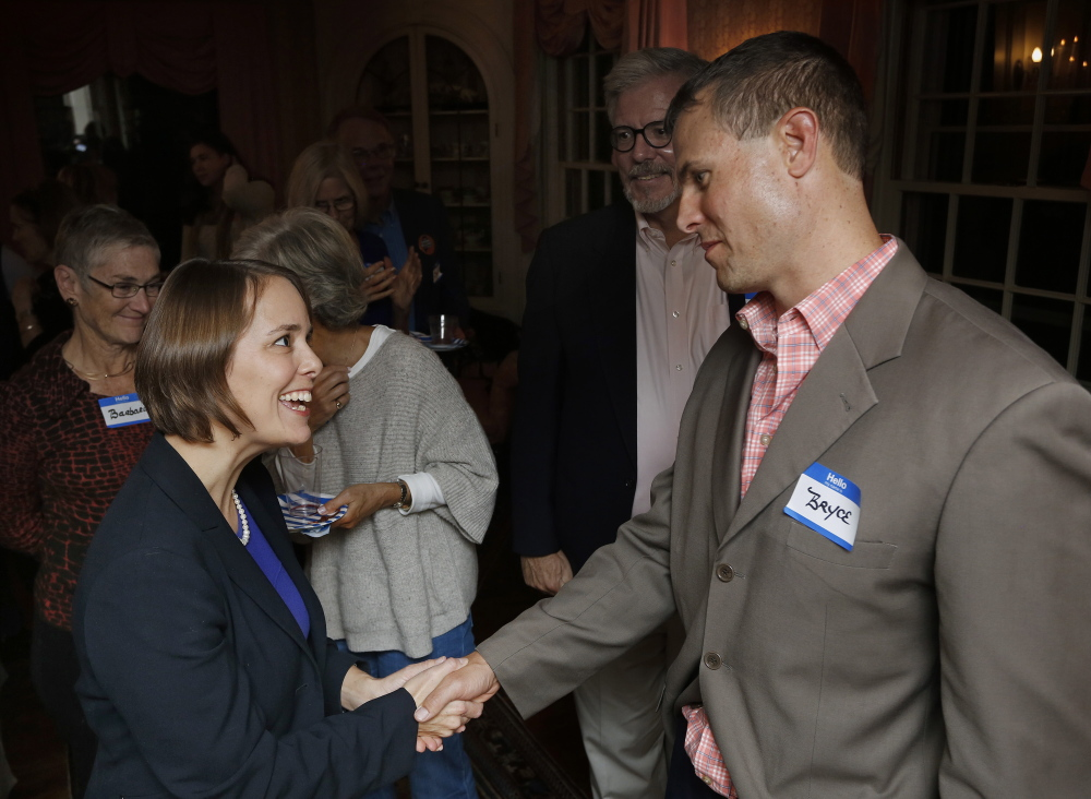 "Shenna Bellows, the Democratic candidate for U.S. Senate, greets Bryce Hach of Falmouth at a fundraiser in Falmouth. ""House parties"" are a mainstay of the Bellows campaign as the race enters the final month."