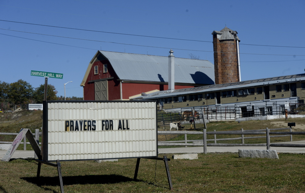 A sign along Route 26 at Harvest Hill Farms Monday marks the tragic hayride accident that occurred Saturday night. Shawn Patrick Ouellette/Staff Photographer)