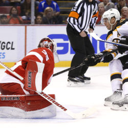 Boston Bruins center David Krejci scores against Detroit Red Wings goalie Jimmy Howard in the first period of Wednesday night's game in Detroit.