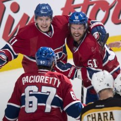 Montreal's Brendan Gallagher, left, and David Desharnais celebrate a power-play goal by teammate Max Pacioretty against the Boston Bruins in first period of Thursday night's game in Montreal.