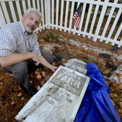 SCARBOROUGH, ME - OCTOBER 15: Mike Waters at his great-great-great grandfathers, Henry Farr, grave in Scarborough where he will replace a old wooden head stone with a new granite one. (Photo by John Patriquin/Staff Photographer)