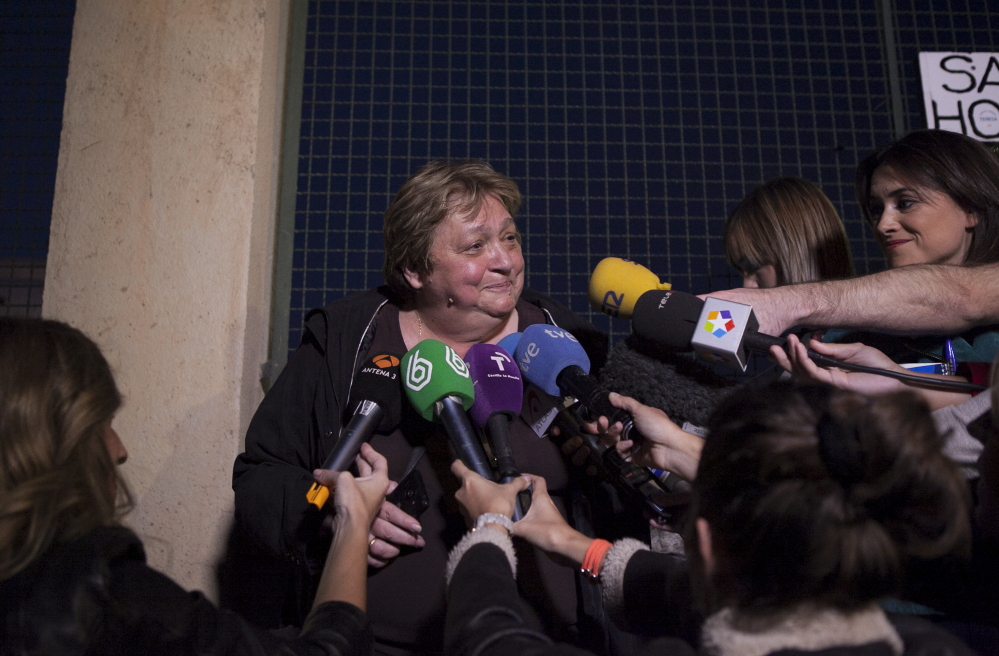 Teresa Mesa, center, spokesperson of Ebola patient Teresa Romero attends the media in front of the Carlos III Hospital in Madrid, Spain.