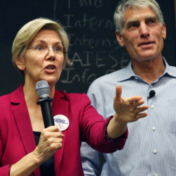 Sen. Elizabeth Warren, D-Mass., left, urges the re-election of Colorado Sen. Mark Udall at a rally Friday at th
