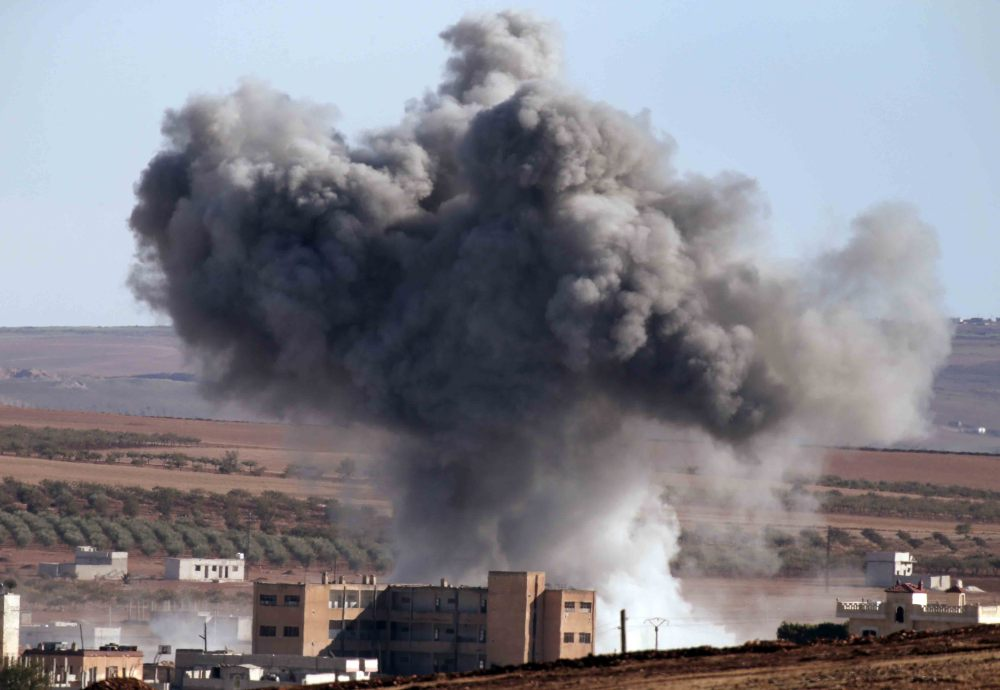 U.S.-led coalition warplanes make an airstrike in Kobani, Syria, in this 2014 photo.
