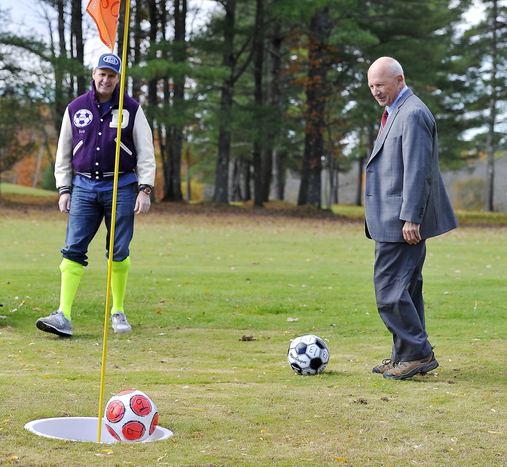 Comedian Bob Marley, left, watches as his par putt bounces out of the hole while Portland Mayor Michael Brennan lines up his put on the first hole as Riverside Golf Course introduces footgolf on its South Course.