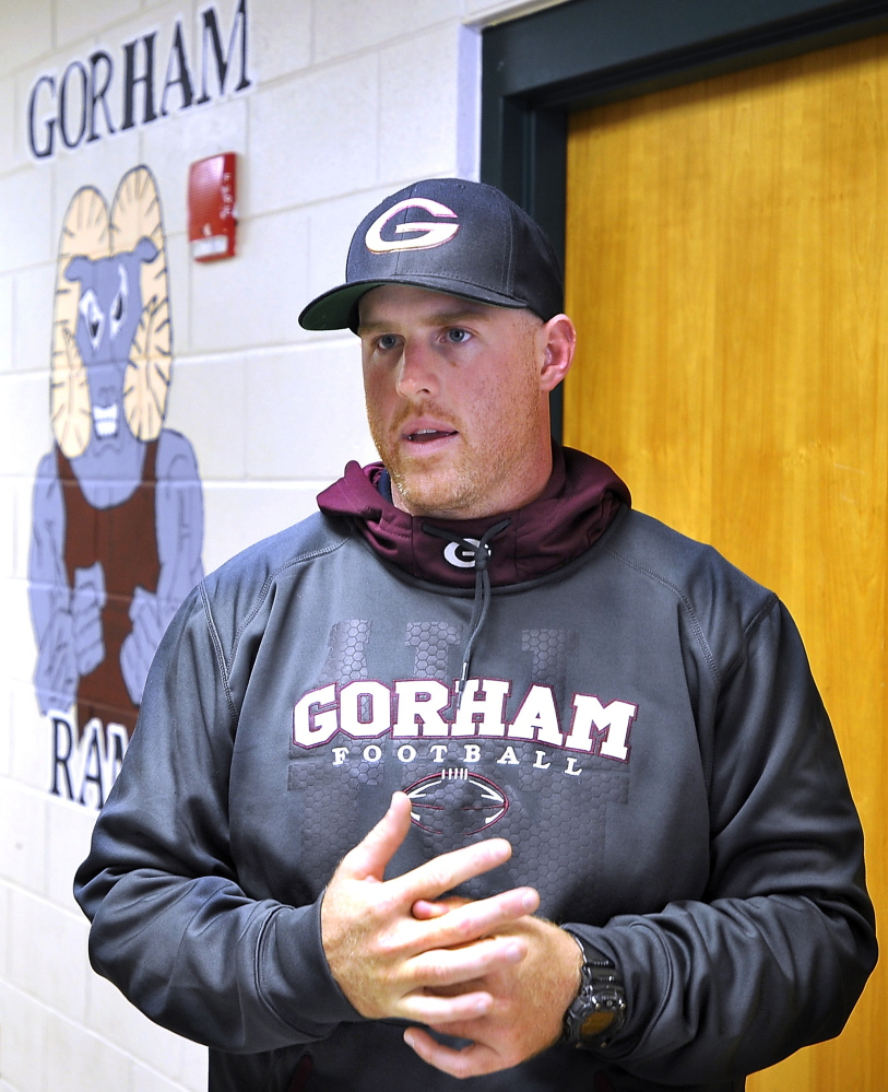 """Gorham High School football coach Andy Hager discusses the death of lineman Branden Denis in a car accident Sunday. """"Everything he did was for the team,"""" one teammate said."""