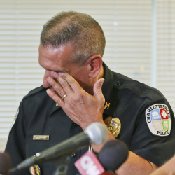 Charlottesville Police Chief Tim Longo wipes his eyes as he and Albermarle County police Col. Steve Sellers brief the media on the discovery of human remains in Albermarle County during a news conference in Charlottesville, Va., on Saturday.