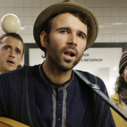 Andrew Kalleen joins other performers during a protest in the Metropolitan Avenue Subway station Tuesday.