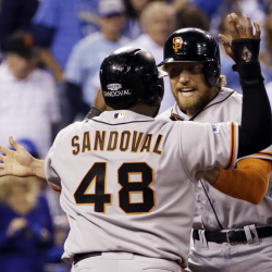 The Giants got off to a great start Tuesday night, scoring three times in the first inning to open the World Series against the Royals, two of the runs on a homer by Hunter Pence, right, that scored Pablo Sandoval.