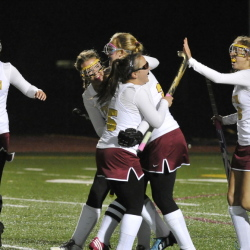 Grace Decker of Thornton Academy, center, is congratulated by teammates after scoring the first goal Wednesday night on the way to a 3-1 victory against Falmouth in the Western Class A field hockey quarterfinals at Saco.