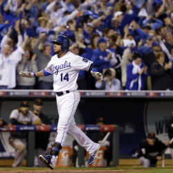 Kansas City's Omar Infante celebrates after hitting a two-run home run during the Royals' sixth-inning rally in Game 2 of the World Series on Wednesday night in Kansas City.