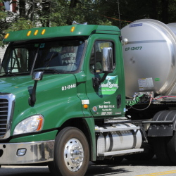 A Poland Spring tanker truck rolls through Fryeburg. Maine regulators have approved a contract allowing the Fryeburg Water Co. to sell water to Nestle Waters, which owns Poland Spring.