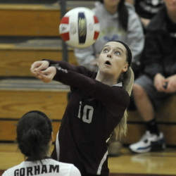 Ciara Stillson of Gorham keeps her concentration on the ball and returns it against Windham. Gorham lost the first set, then recovered to capture the next three.