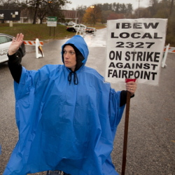 Susan Baron, right, a member of the International Brotherhood of Electrical Workers union, pickets Thursday outside the FairPoint building in Portland. With her are fellow strikers Brooke Blake and Julie Dubail. About 2,000 FairPoint workers walked off the job on Oct. 16.
