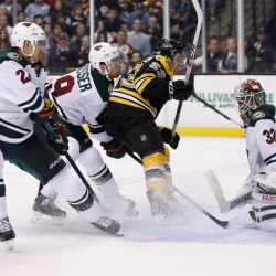 Boston Bruins' center Seth Griffin scores on Minnesota Wild goalie Niklas Backstrom in the second period of Tuesday night's game in Boston. The Bruins built a 3-1 lead after two periods but lost it in the third.