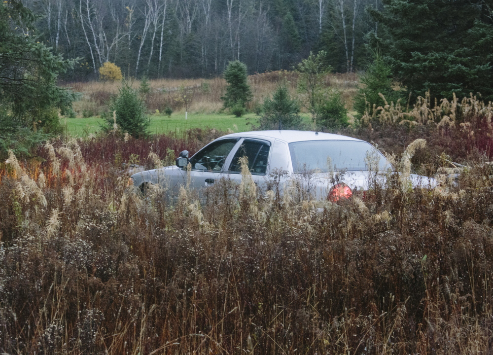 An unmarked Maine State Police Trooper sits outside the home of Ted Wilbur, where Kaci Hickox returned Tuesday evening in Fort Kent, ME on Wednesday. A uniformed officer said the Maine State Police was there to work with the CDC, to watch for safety and movement at the home. Whitney Hayward/Staff Photographer