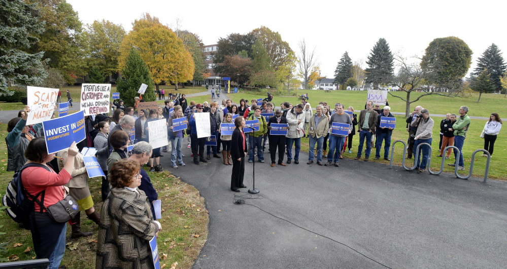 Economics professor Rachel Bouvier joins a rally near Payson Smith Hall on the Portland campus of the University of Southern Maine on Wednesday. The cuts are part of a plan to close a $16 million budget gap in the next fiscal year.