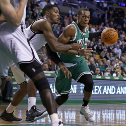 Celtics guard Rajon Rondo dribbles against Brooklyn Nets guard Joe Johnson in the first quarter of Wednesday night's season-opening game in Boston.