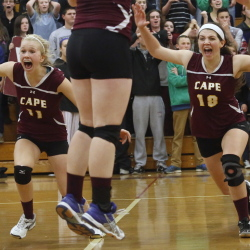 With the big comeback over, it's time to celebrate for the Cape Elizabeth volleyball team. Katie Connelly and Monica Dell'Aquila rush the bench after the Capers beat Greely 3-2 in the Class A semifinals on Wednesday. Cape lost the first two sets before winning the final three.