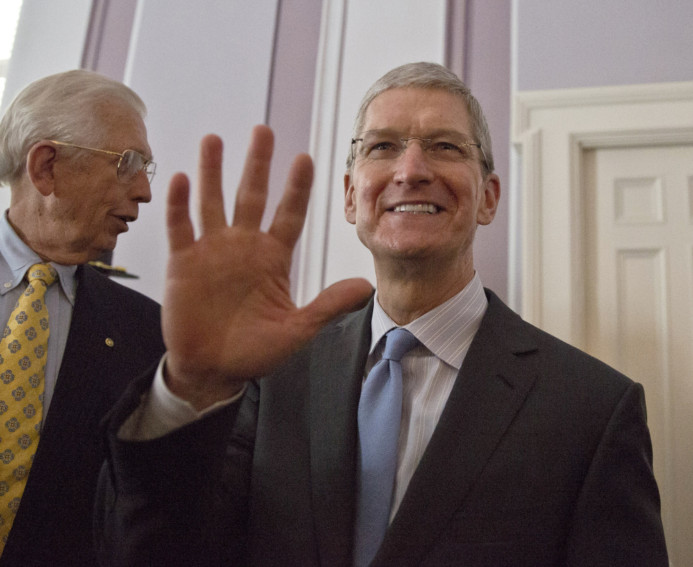 Apple CEO and Alabama native Tim Cook waves before he is honored by the Alabama Academy of Honor at the Capitol on Monday, in Montgomery.