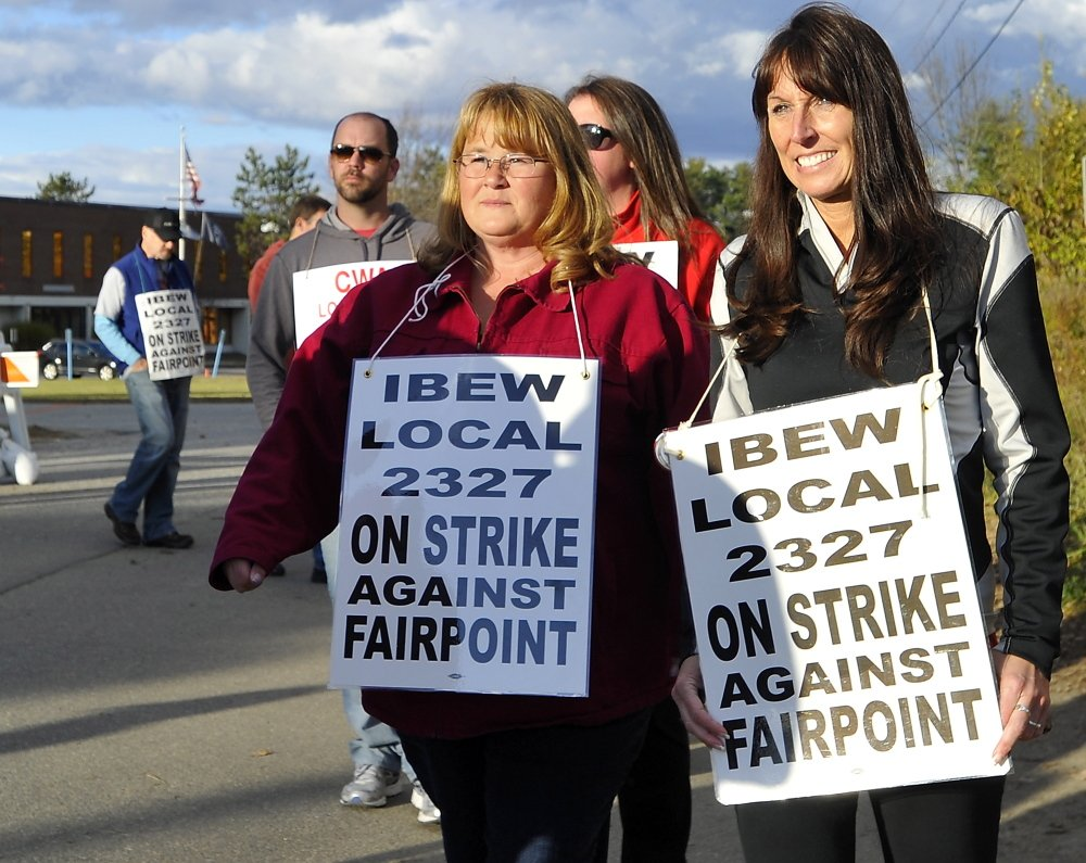 Striking workers picket outside FairPoint offices in Portland in October. The two sides are heading back to bargaining, although a date has not yet been set.