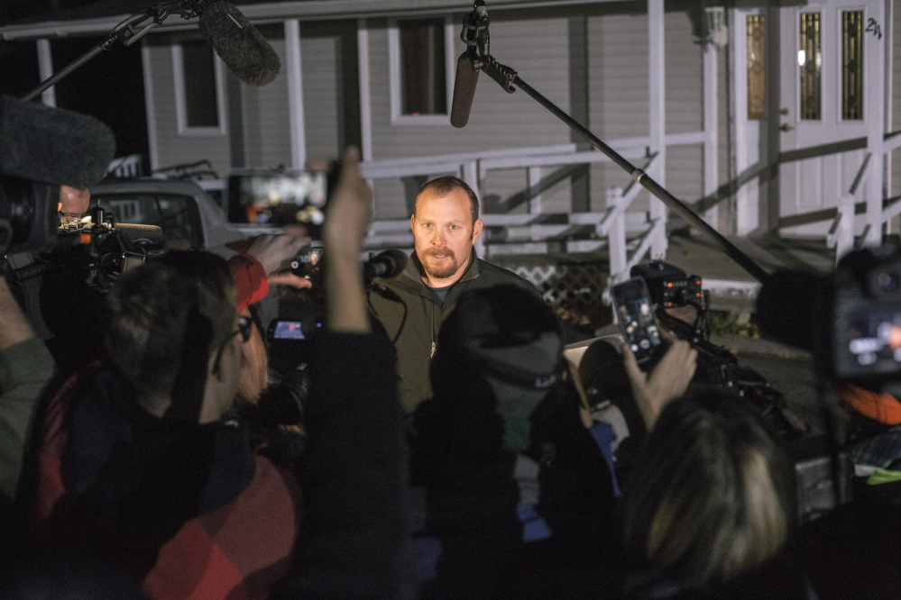 Kaci Hickox's boyfriend Ted Wilbur talks to media members outside his Fort Kent home Thursday. He declined to discuss the legal dispute between Hickox and state officials, said she wouldn't be saying anything else that day, and suggested that reporters go get some dinner.