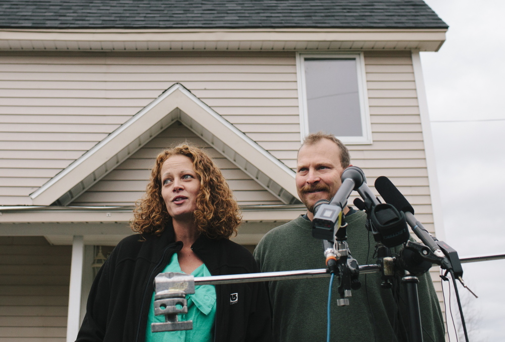 Kaci Hickox and Ted Wilbur hold a news conference outside their home in Fort Kent on Friday. Hickox said she hoped Wilbur would make her favorite sushi dish Friday and they would watch Halloween horror movies in an attempt to return to a normal life.
