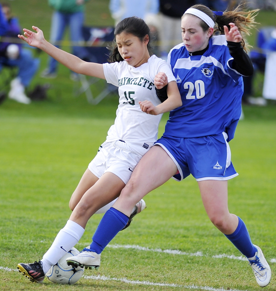Waynflete Molly McNutt, left, fights for possession with  Abby Hughes of Sacopee Valley. Sacopee Valley will play for the regional championship on Wednesday at Maranaoook.