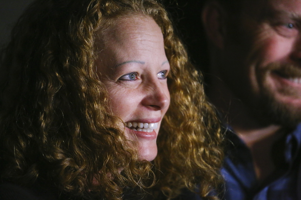 Kaci Hickox speaks to the press outside her boyfriend's home on Wednesday night. She said she has been told that Maine's attorney general intends to file legal action, and if that occurs, she will fight it.
