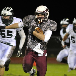 Windham's Griffin Jacobson finds some running room in Friday night's game against Bonny Eagle. Windham improved to 7-1 with a 26-6 victory over the defending Class A state champions.