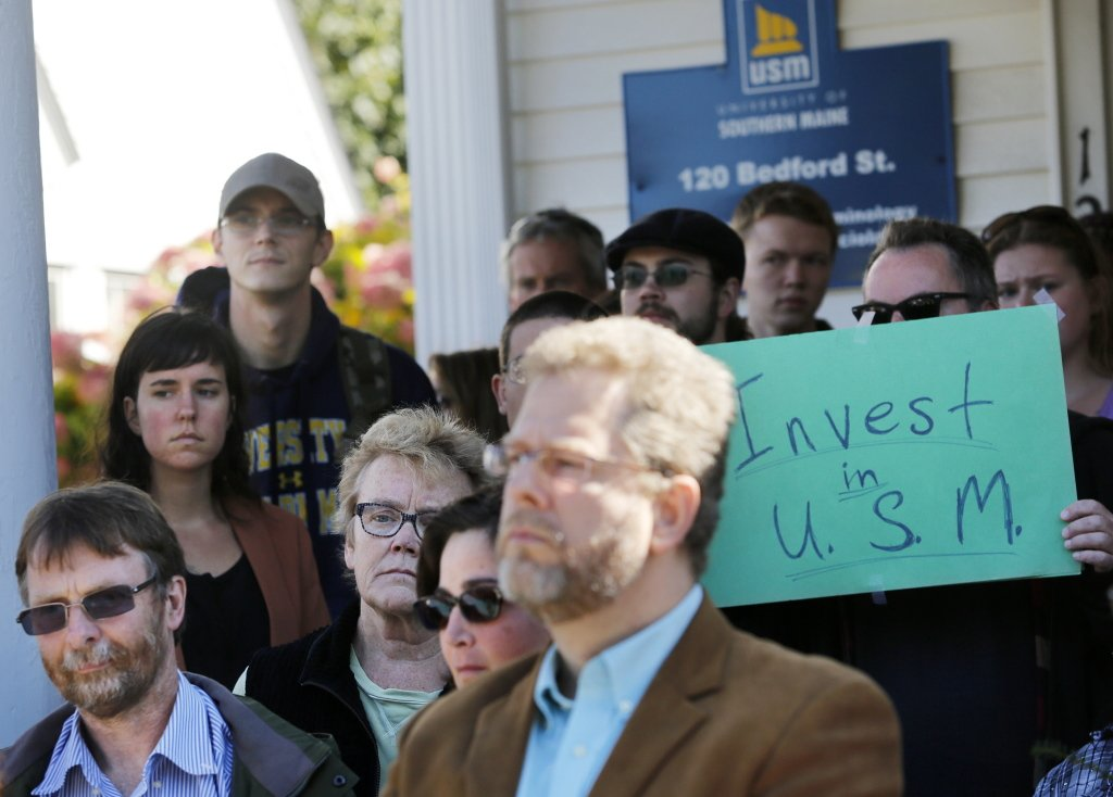 Students and faculty members show their displeasure at a press conference after Monday's announcement of faculty layoffs at the University of Southern Maine.