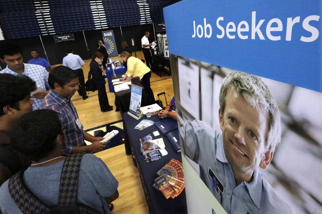 Students attend The Foot in the Door Career Fair at the University of Illinois in Springfield, Ill., last week. September's job gains mean that more Americans are earning paychecks and can spend more. The Associated Press