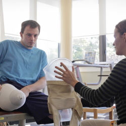 """Tim Niles, left, learns how to wear his prosthetic leg during a session last month with physical therapist Lindsay Dunstan at the New England Rehabilitation Hospital in Portland. """"Nothing is going to stop me,"""" says Niles, who is a former Old Town High School sports star. Amelia Kunhardt/Staff Photographer"""
