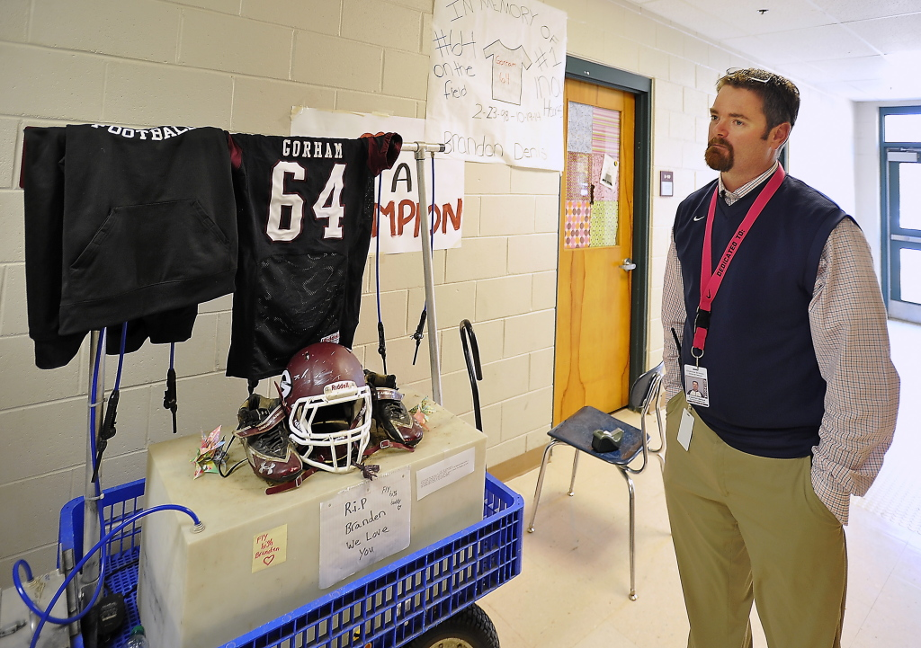 Gorham High School Athletic Administrator Timothy Spear stands by the school's tribute to Branden Denis, who died in a traffic accident Sunday in Bridgton.