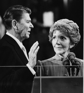 Nancy Reagan proudly watches as her husband Ronald Reagan takes the oath of office at the Capitol January 20, 1981. The Associated Press