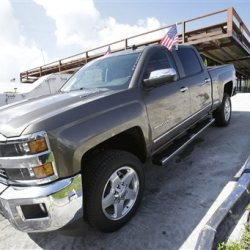 """A 2015 Chevrolet Silverado 2500 4WD LTZ Crew Cab pickup truck is on display at a dealership in Miami Lakes, Fla. """"The new trucks and SUVs are more profitable than the ones they replaced,"""" says GM Chief Financial Officer Chuck Stevens. The Associated Press"""