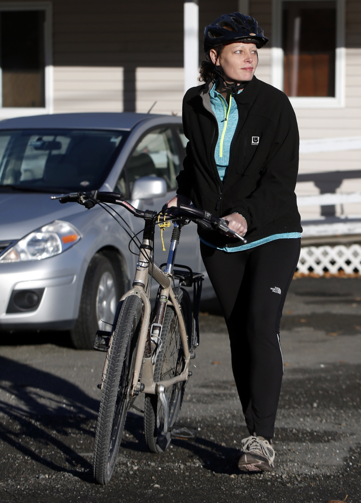 Nurse Kaci Hickox leaves her home on a rural road in Fort Kent to take a bike ride with her boyfriend, Ted Wilbur, on Thursday.