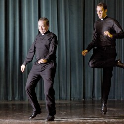 Father David Rider, left, and father John Gibson show off their dance moves prior to an interview at the Pontifical North American College in Rome. A video of a pair of dueling, dancing American priests studying in Rome has gone viral.