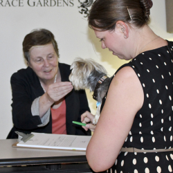 Ellen Bornet, of Rose Associates, left, general manager of London Terrace Gardens in New York, greets resident Lisa Bulloch-Jones and her Maltese-Yorki mix, Marley, as Bulloch-Jones fills out a permission to enter form for her dog walker. Pet security deposits register in the hundreds of dollars and are getting steeper. Apartment managers nationwide say they require some safety net against pet damage, while others won't allow animals at all. The Associated Press / Rose Associates