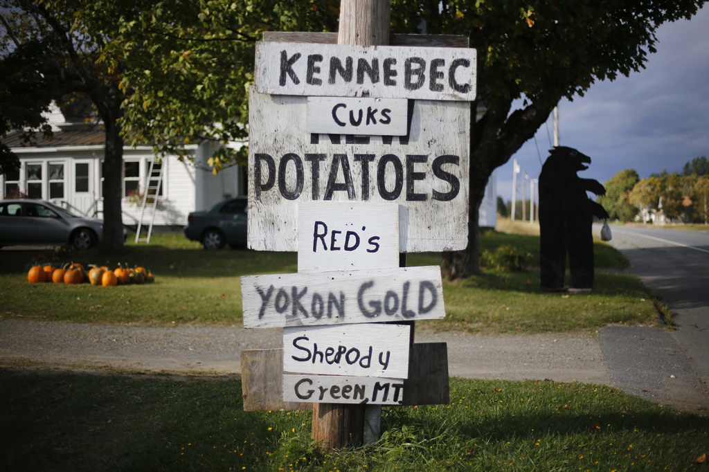 Signs advertise some of the varieties of potatoes for sale outside a farm near Houlton. Farm income, a small component of personal income, increased nearly 60 percent in Aroostook County in 2013.