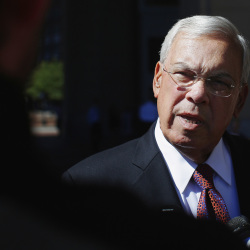 Boston Mayor Tom Menino talks to reporters as he arrives for the Boston College Chief Executives' Club of Boston luncheon in Boston on Sept. 25, 2013, one day after the preliminary runoff to elect a new mayor to succeed Menino, who said he would not seek an unprecedented sixth term in office.
