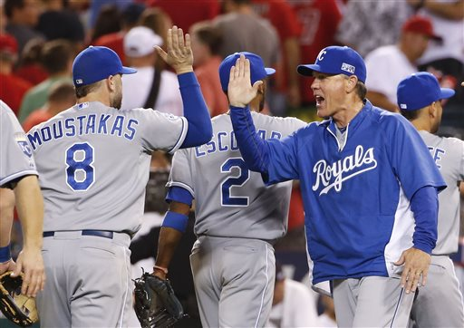 Kansas City Royals manager Ned Yost, right, celebrates with Mike Moustakas after the Royals' 3-2 win over the Los Angeles Angels in 11 innings in Game 1 of baseball's AL Division Series in Anaheim, Calif., Thursday. Moustakas hit a home run in the 11th inning. The Associated Press